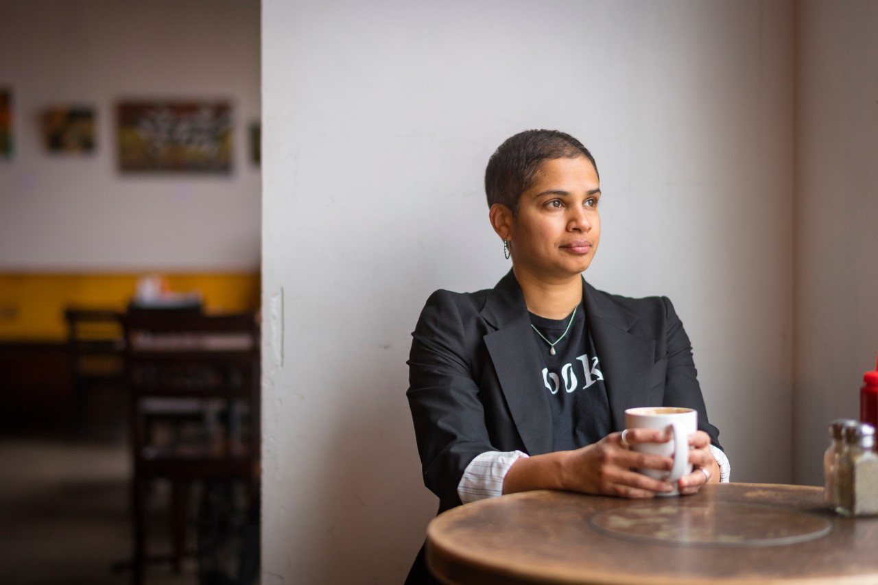 Image of Tanya Boteju drinking coffee